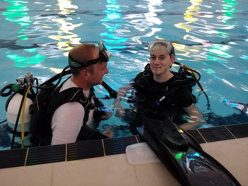 Instructor in pool with try diver - Trying SCUBA.
