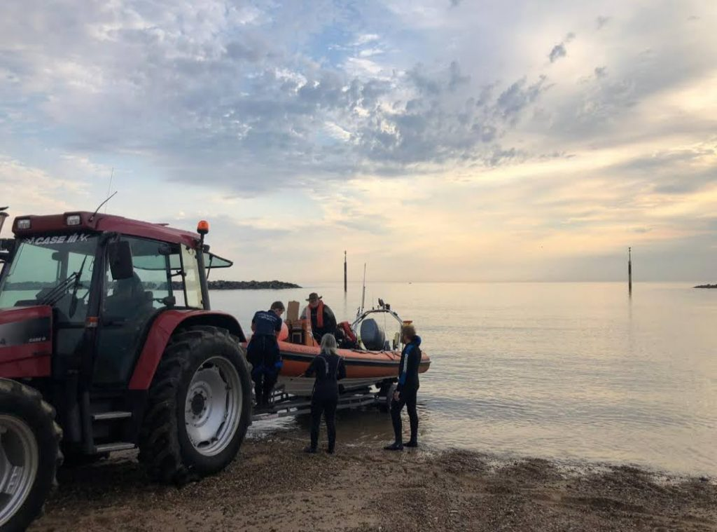Launching Lowestoft Diver into the sea at Sea Palling with the tractor.