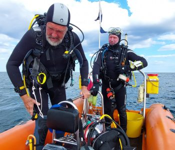 Ken Wooley and Nigel Powley getting ready to dive
